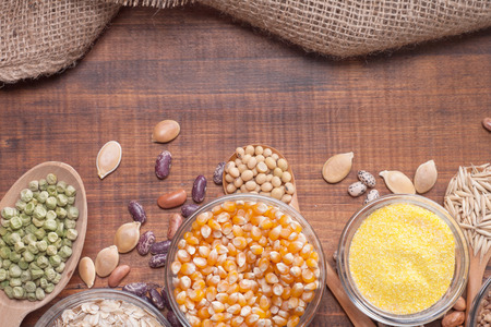 Cereal grains , seeds, beans on wooden background.  photo