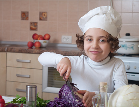 child preparing healthy food vegetable salad photo