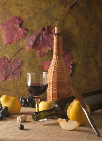 vine pear: bottle with red wine and glass