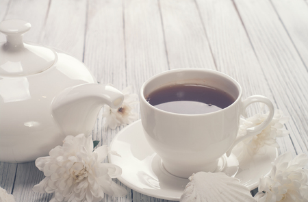 sweet pastries: Tea cup served on wooden table Stock Photo