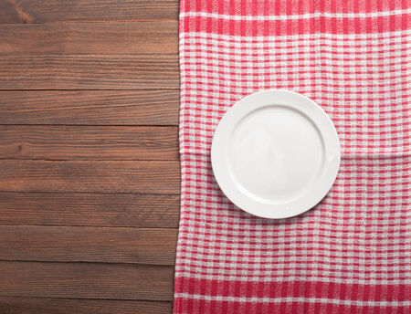 place mat: Empty plate on tablecloth on wooden table Stock Photo