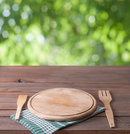 Empty tray on tablecloth on wooden table photo