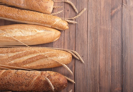 different types of baguette on a wooden background photo