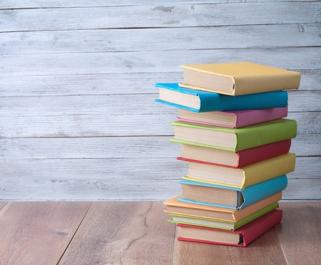 orders: Books on a wooden  background.
