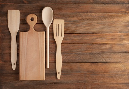 different wooden spoons on the table photo