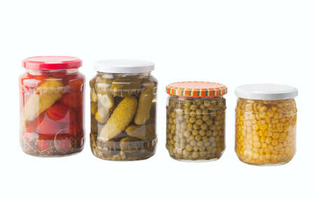 canned peas: Vegetables  preserved in jars isolated on white background
