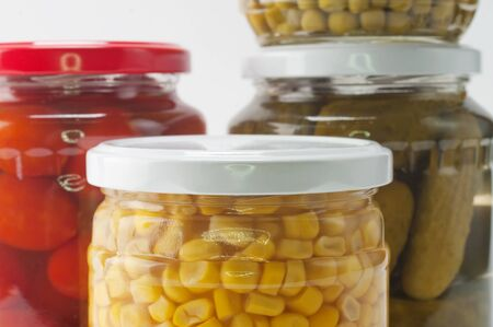 canned peas: Vegetables  preserved in jars Stock Photo