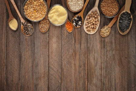 Cereal grains , seeds, beans on wooden background. Imagens - 36748490
