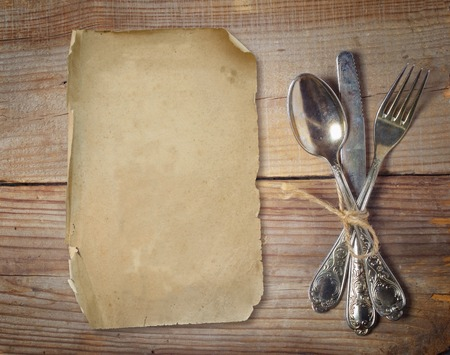 old cutlery on wooden table photo