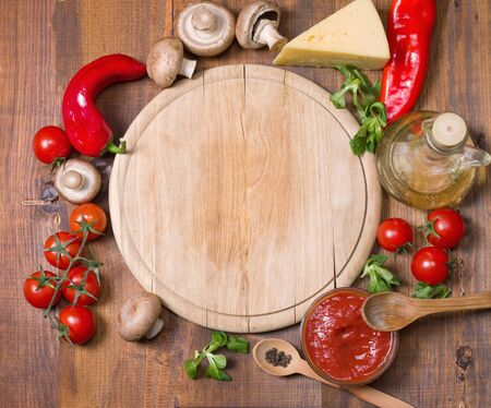 pizza ingredients: Pizza ingredients  and tray on wooden board