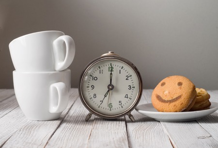 Morning  coffee with alarm clock on table photo