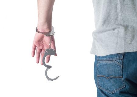 man in jail: man hands in handcuffs