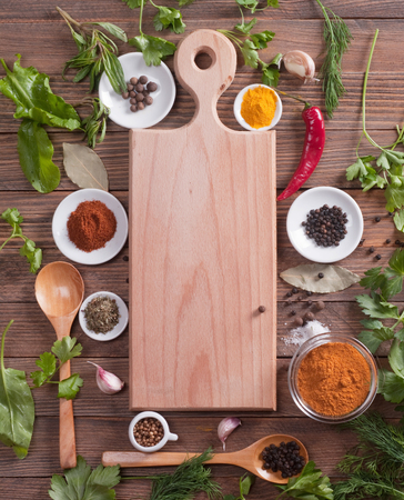 cutting board spices and vegetables. photo