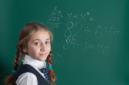 blackboard background: schoolgirl and school board