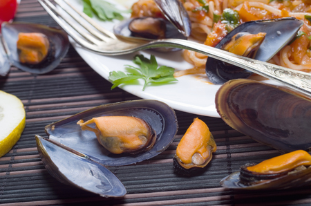Spaghetti with Mussels in a homemade tomato sauce photo