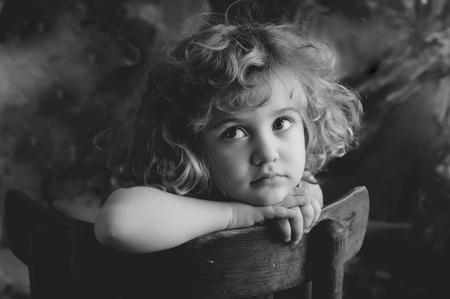 foster: Dreaming beautiful little girl, monochrome portrait
