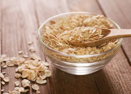 heaped: rolled oats heaped in a glass bowl