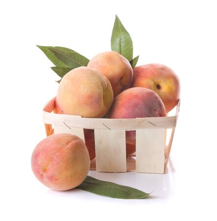 peach: peaches in basket isolated Stock Photo