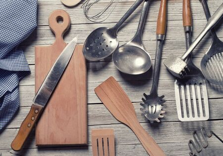 cooking utensil: various kitchen utensils on wooden table