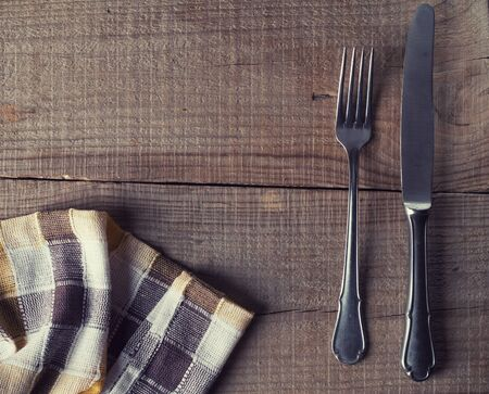 grunge silverware: old cutlery on wooden table