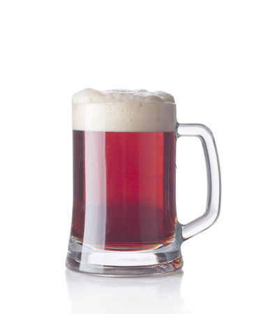 froth: Dark beer glass with froth isolated on a white background
