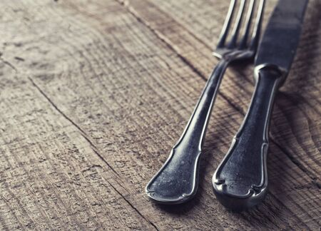 cutleries: old cutlery on wooden table