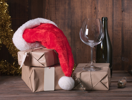 mail: boxes with Christmas presents and santa hat on a wooden background Stock Photo