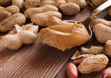 peanut butter: Delicious peanut butter in spoon