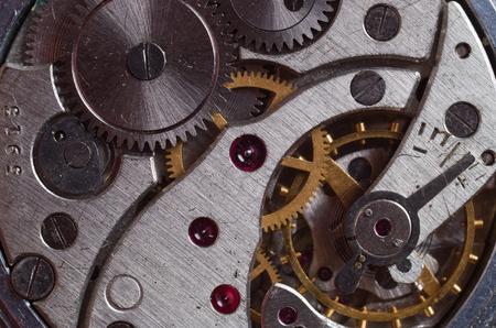 gearwheel: Metal gears of old clock mechanism Stock Photo
