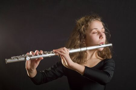 young musician: Girl Playing Flute Stock Photo