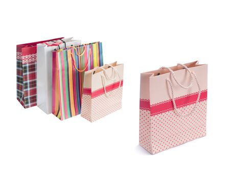gift bags: Colourful paper shopping bags isolated on white Stock Photo