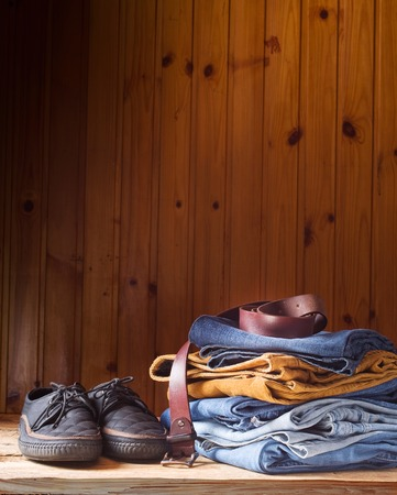 collections: clothes and mens accessories on brown wood background