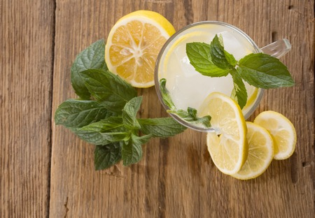 cold background: Cold fresh lemonade drink on a wooden background Stock Photo