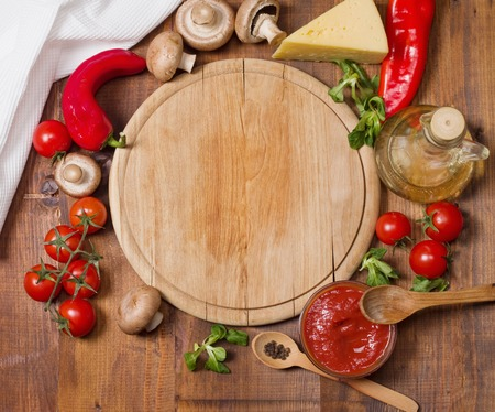 veggie tray: Pizza ingredients and tray on wooden board