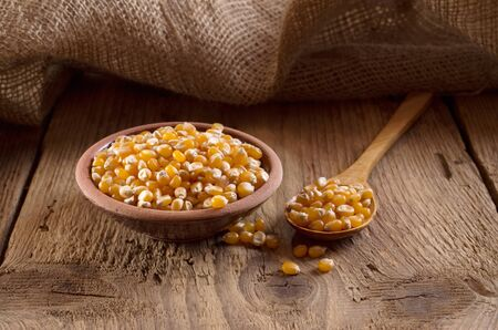 spoon yellow: Yellow corn in a wooden spoon
