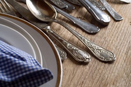 grunge cutlery: old cutlery on wooden table