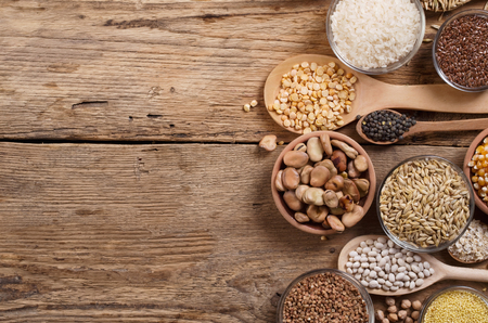 rye: Cereal grains , seeds, beans on wooden background.