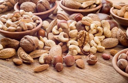 Nuts mix, with almond, cashews, pistachios, hazelnuts on wood background Foto de archivo