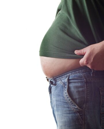 overeat: big belly of a fat man isolated on white