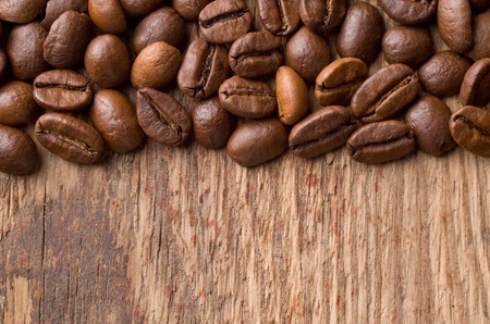 coffee beans: Coffee on grunge wooden background