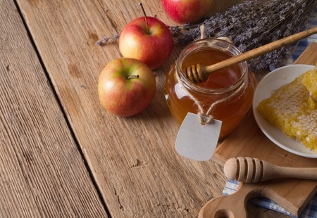 apple and honey: Honey jar with dipper Stock Photo