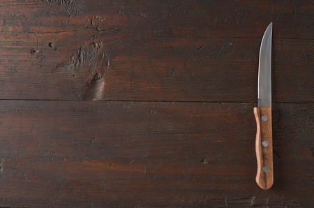 Knife on rustic kitchen table