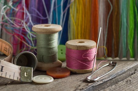 thimble and needles for sewing close-up