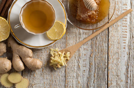 Ginger tea with lemon on a wooden table