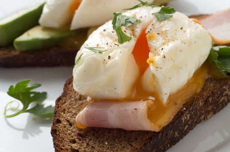 Poached egg on toast, with smoked bacon