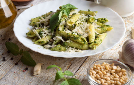 Penne Pasta with Pesto Sauce on White Plate