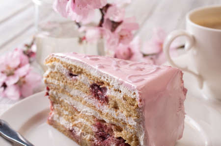 Pink cake on a wooden table