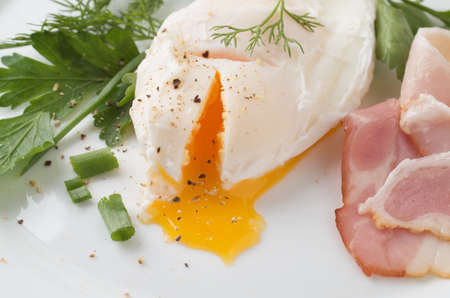 Poached eggs on white plate