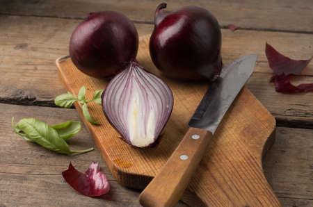 Fresh red onion on a cutting board