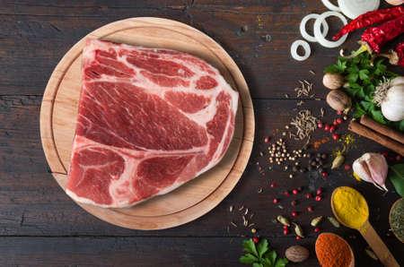 Raw beef steak with spices Standard-Bild